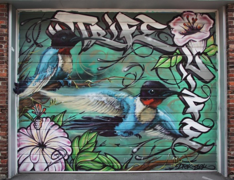 Trife Life painting on garage door
