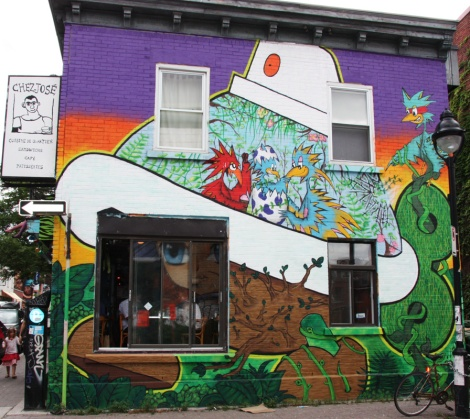 Futur Lasor Now bird with Turtle Caps on side of Chez José on Duluth