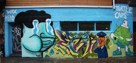 Mural in alley behind St-Laurent featuring Waxhead (left), Ether TFB (centre) and Turtle Caps (right)