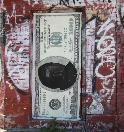 Large currency wheatpaste by G. Knight on door of the George General d'Auto Reparation