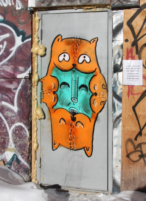 Waxhead on door in alley between St-Laurent and Clark