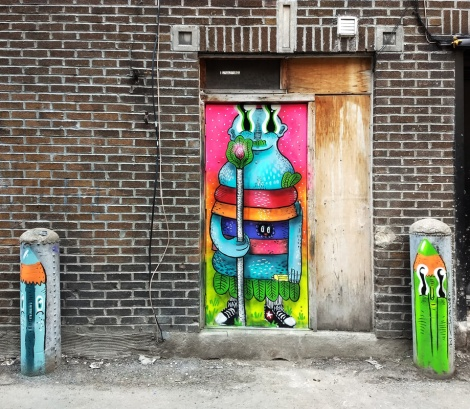 Waxhead on alley door and 2 bollards