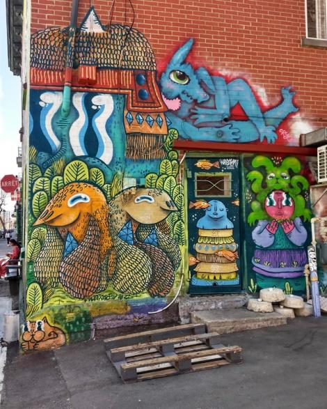 Waxhead and Cryote on the back wall of a Plateau café