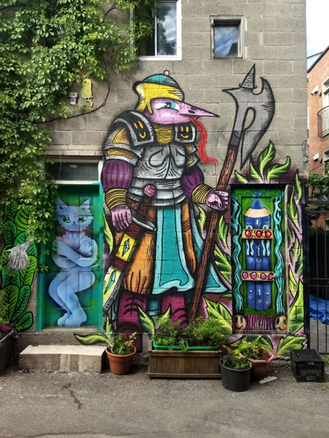 Waxhead between doors featuring Cryote (left) and himself (right) in Mile End. Visible in the foliage are woodups by Starkey and Flavor.