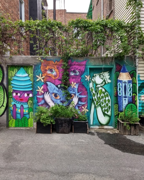 Waxhead (left door), Cryote (middle), Labrona (right door) and Waxhead (right), in a Mile End alley