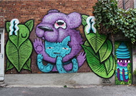 Cryote (central figures) and Waxhead (leafy figures and door) in a Mile End alley