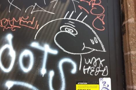 Waxhead on a Mile End door