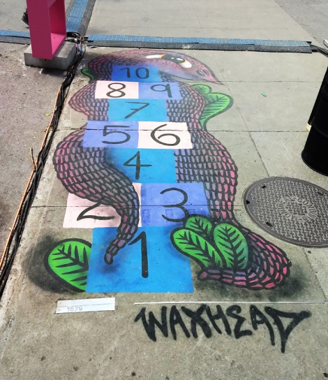 sidewalk piece by Waxhead for the 2019 edition of Mural Festival