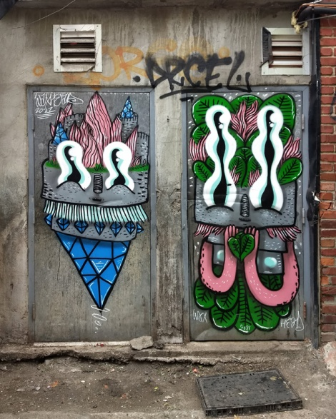 set of 2 doors by Waxhead in a Plateau alley