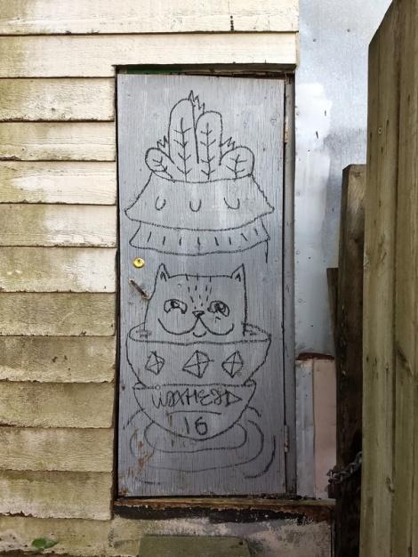 Waxhead on a Plateau alley door