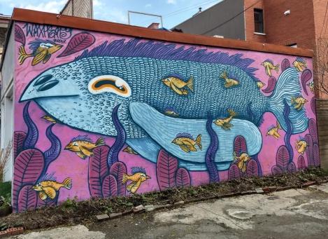Waxhead mural in a Petite Patrie alley