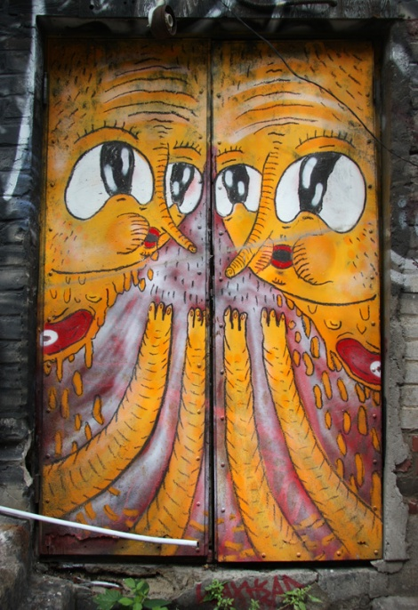 Waxhead on doors in alley behind St-Laurent