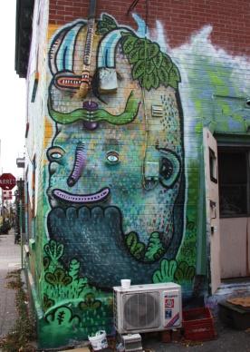 Waxhead mural behind Chez José on duluth