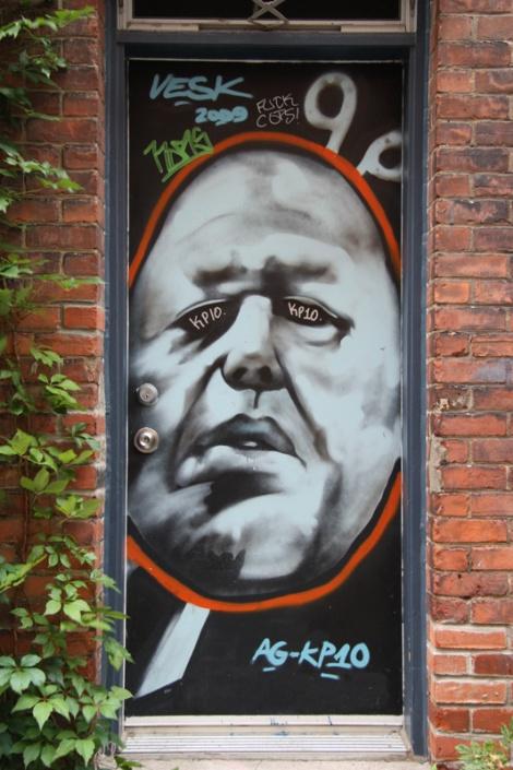 piece by unidentified artist on door