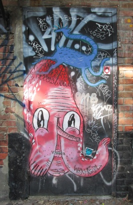 Waxhead (in red) and Cryote (in blue), and a lot of tags on door in alley between St-Laurent and Clark