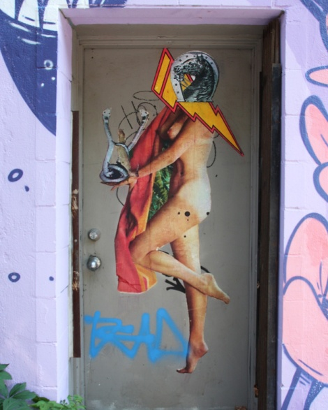Elsol wheatpaste in a Plateau door frame