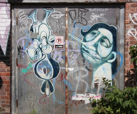 Gawd (left) and Labrona (right) on Mile End back alley doors