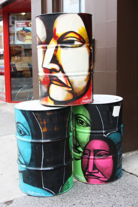 Painted Labrona pieces on barrels in front of Hochelaga barrels