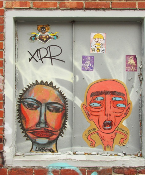 Labrona (left) and Mono Sourcil (right), wheatpastes on St-Dominique with stickers by Graffiti Knight, Turtle Caps and Il Flatcha
