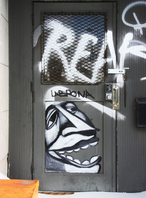 Labrona on the door of an abandoned industrial building in Rosemont