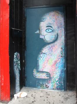 painted door by Waxhead on St-Laurent near Prince-Arthur