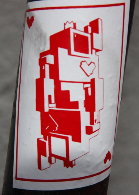 Lovebot sticker, various locations