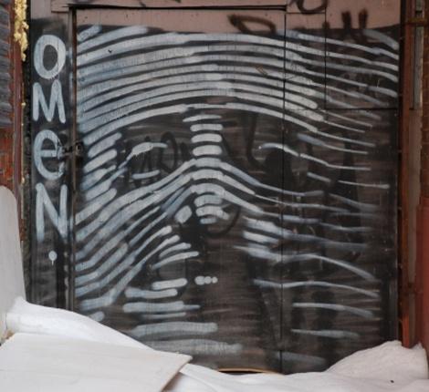 Omen in alley off St-Laurent above Laurier photo © Omen