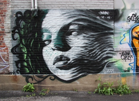 Omen mural in alley between Parc and Jeanne-Mance