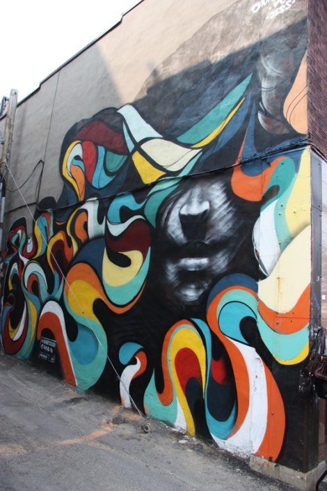 Collaboration mural between Omen and Jess in alley between St-Denis and Drolet