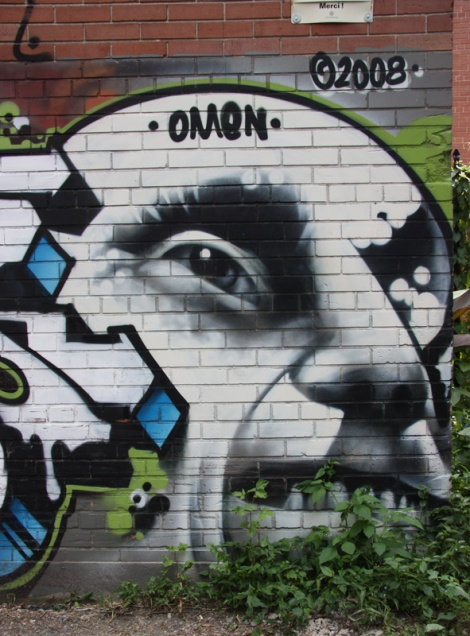 Omen mural in alley behind Laurier