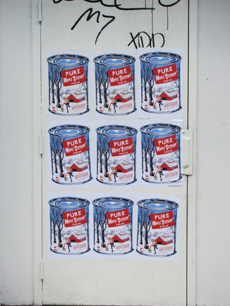 WhatIsAdam paste-ups on door