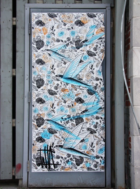 large WhatIsAdam wheatpaste on door