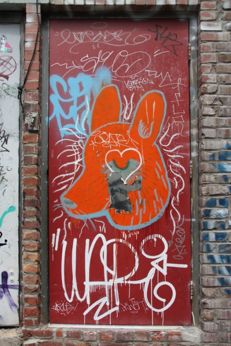 door featuring Cryote and lots of tags in a Plateau alley
