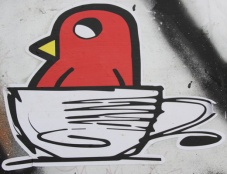 collaboration sticker between ROC514 (bird) and unidentified artist (cup)