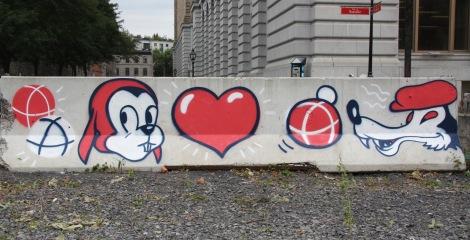 Tava art spray-painted on concrete beam at place d'Youville for the event called 'Pétanque à la place d'Youville'