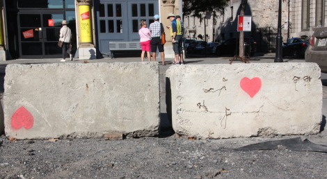Tava art spray-painted on concrete beam at place d'Youville for the event called 'Pétanque à la place d'Youville'