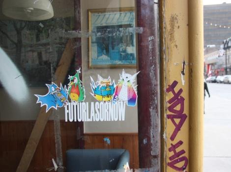 Futur Lasor Now sticker / paste-ups