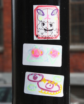 Collaboration sticker featuring Stela and Zu (top) and two stickers by Zu (middle and bottom)