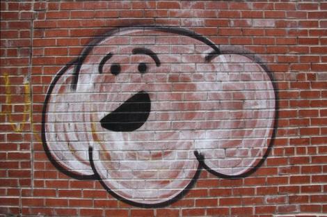 unidentified artist in alley between St-Laurent and Clark