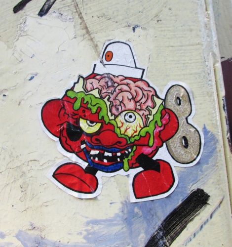 paste-up by Turtle Caps in alley between St-Laurent and Clark