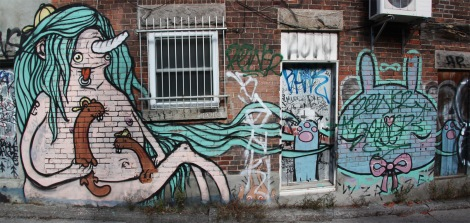 Waxhead and someone else from the Wzrds Gng in alley between St-Laurent and Clark