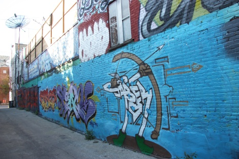 general view of a portion of alley between St-Laurent and Clark; Jaber piece in the forefront