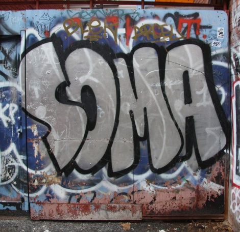 Soma graffiti in alley between St-Laurent and Clark
