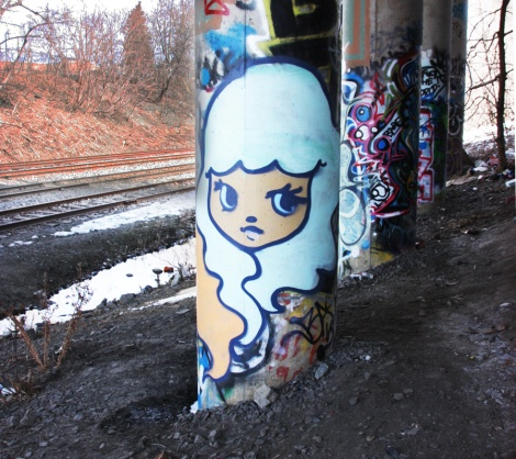 Stela beneath train track overpass