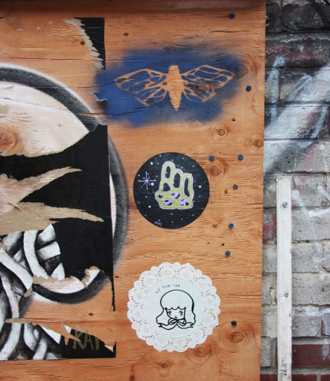 stencil by unidentified artist (top) and small paste-ups by Swarm (centre) and Stela (bottom)