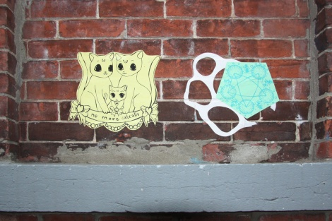 paste-ups by Stela (left) and Swarm (right)
