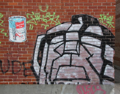 Whatisadam wheatpaste (left) with unidentified artist (right)