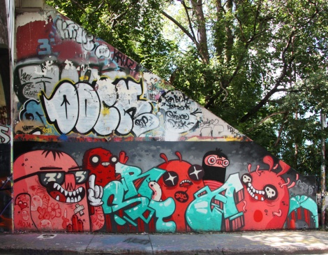 Astro (bottom) and a tribute to Dock (middle) at the Rouen legal graffiti tunnel