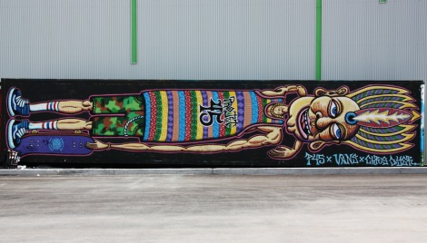 Chris Dyer on the wall of a skateboarding center