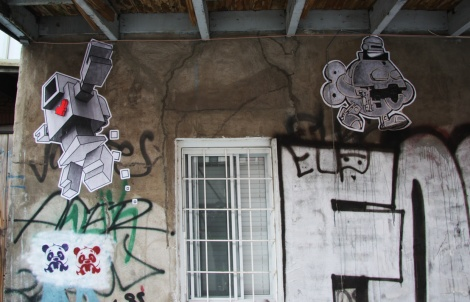 Lovebot (left) and Turtle Caps (right) wheatpastes in alley between Hotel de Ville and Laval